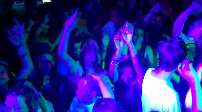 Dancefloor lit by UV light